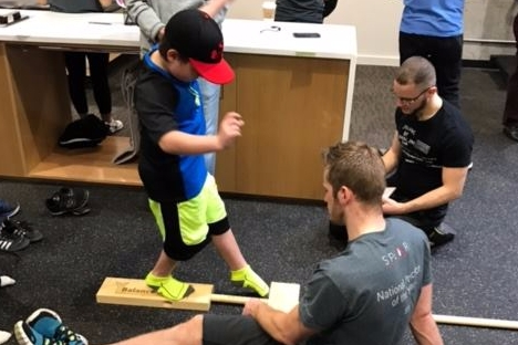 SPEAR's nationally-recognized Physical Therapists volunteer their time to help NYC's youth athletes prevent injury