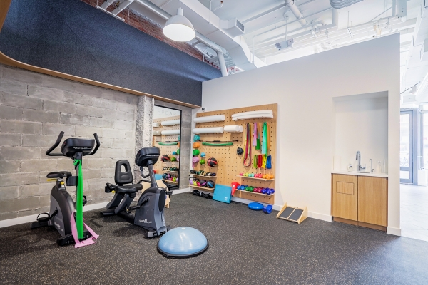 SPEAR PT Tribeca space with cardio machines, resistance bands and open space for stretching