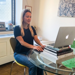 NYC occupational therapist sitting at a desk with a proper ergonomic set up