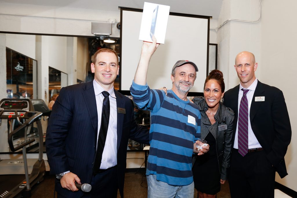 SPEAR CEOs with iPad Mini winner