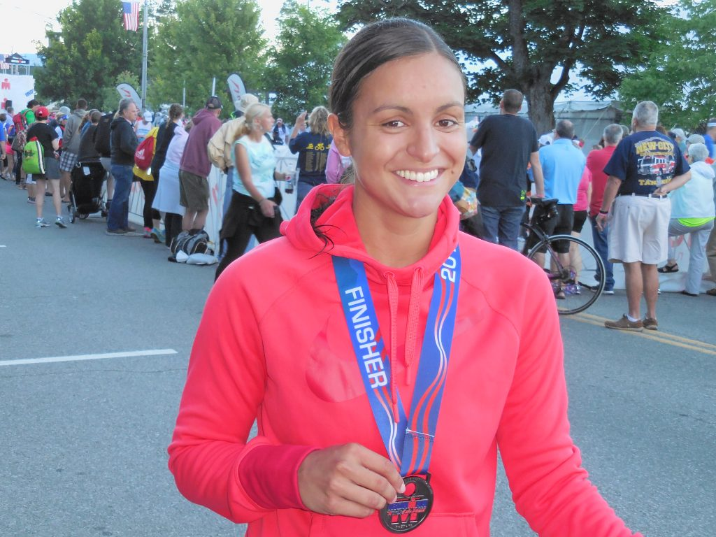 Amelia Completes Ironman and shows medal