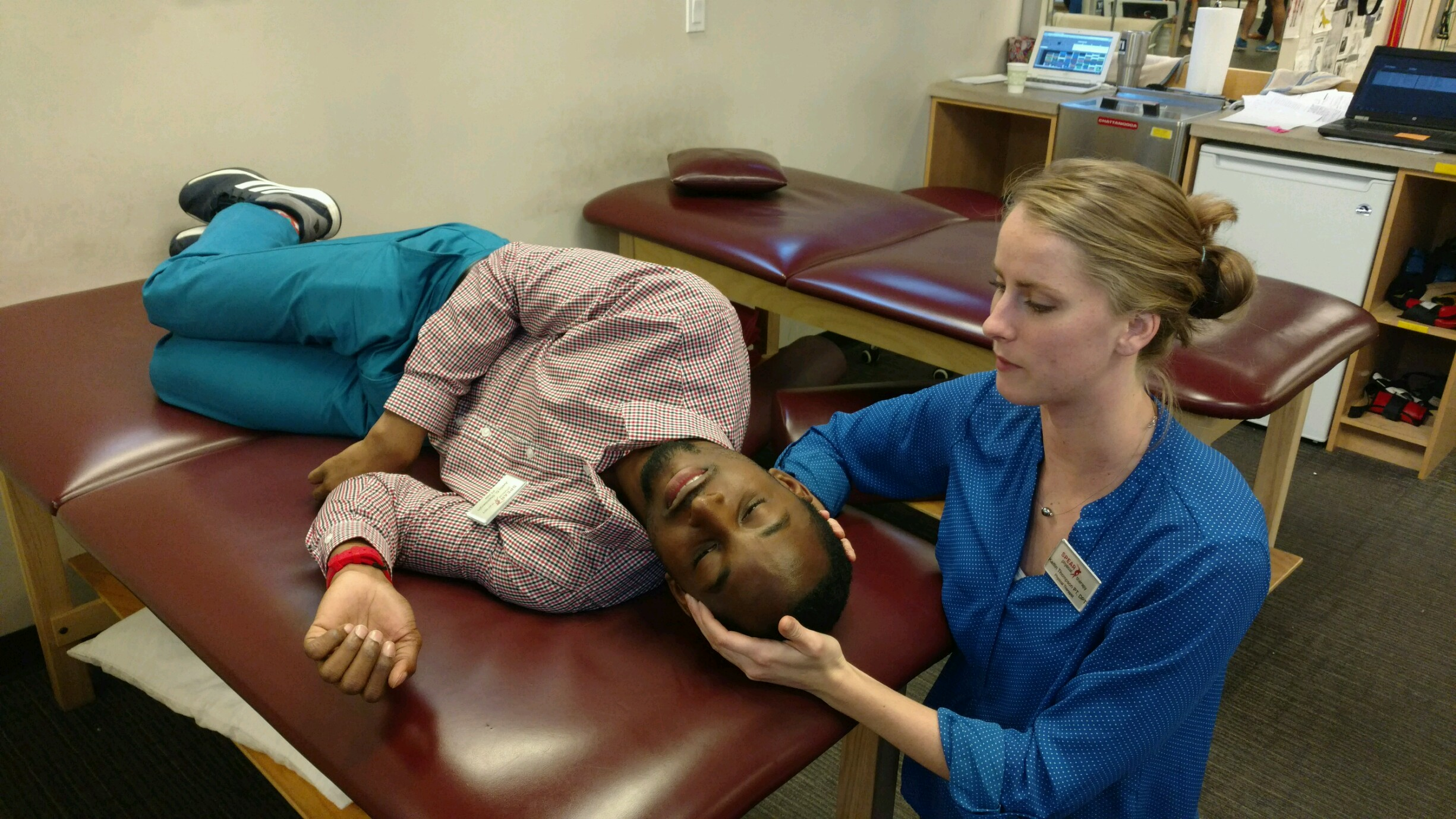 Physical Therapists demonstrating vestibular rehabilitation