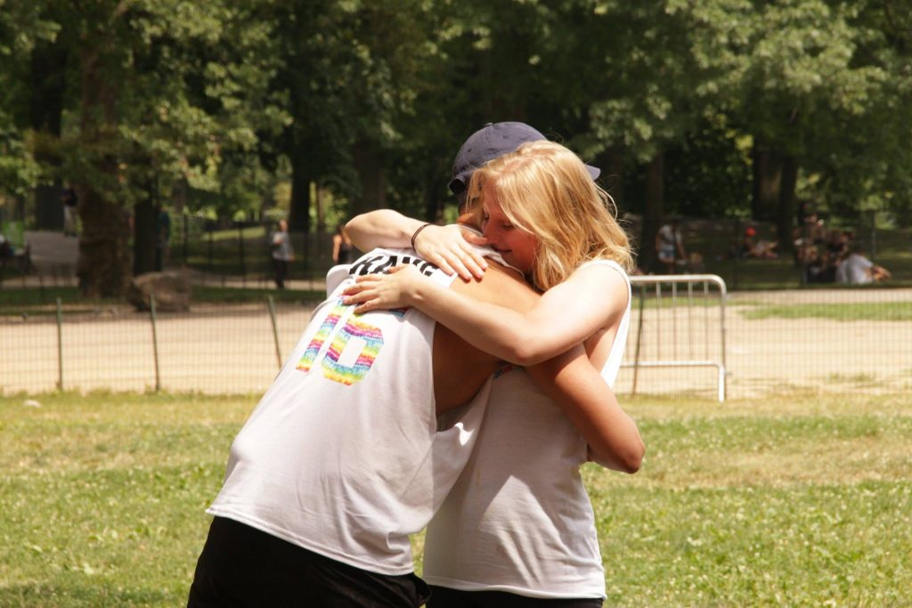 SPEAR Physical Therapists hug in NYC's Central Park, as they grow together to form an amazing physical therapy team.