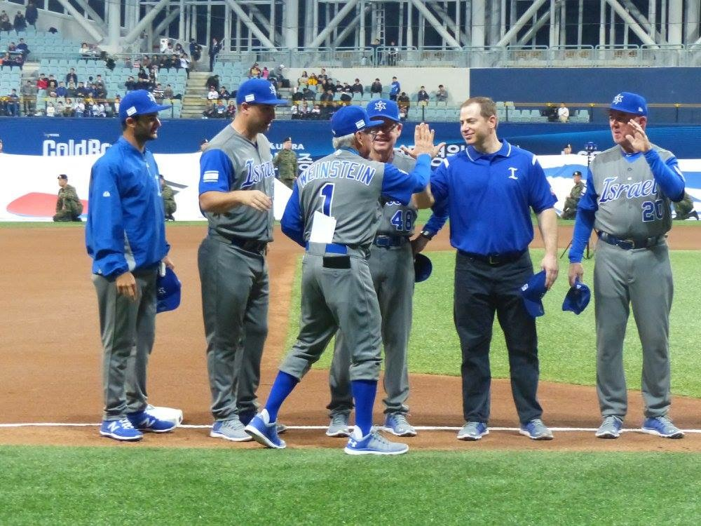 Dan Rootenberg and team Israel shake hands