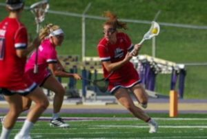 Female lacrosse player swinging her crosse