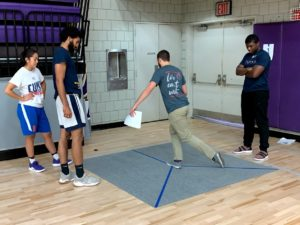 SPEAR PTs demonstrate an exercise for Hunter College basketball players.