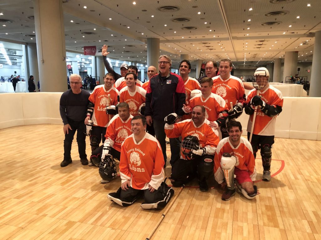 Long Island Lions floor hockey team smiling after a championship game at the Special Olympics
